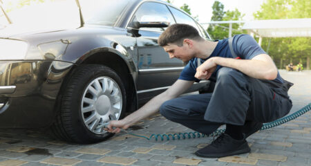 Drivers Check Car Tyres